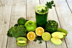 green juice with vegetables around it