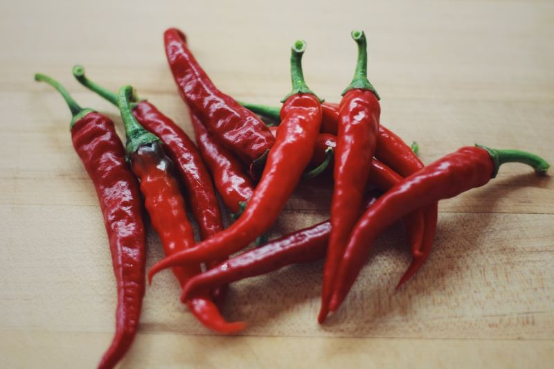 Cayenne-Peppers-on-a-wooden-board