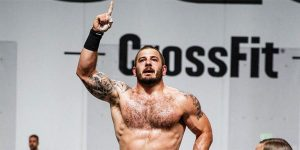 mat-fraser-crossfit-standing-with-one-hand-up