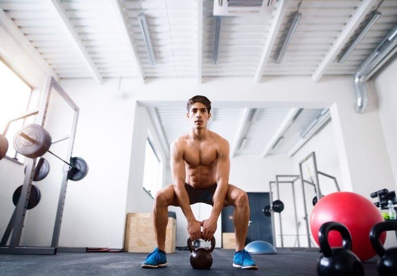 man doing kettlebell goblet squat