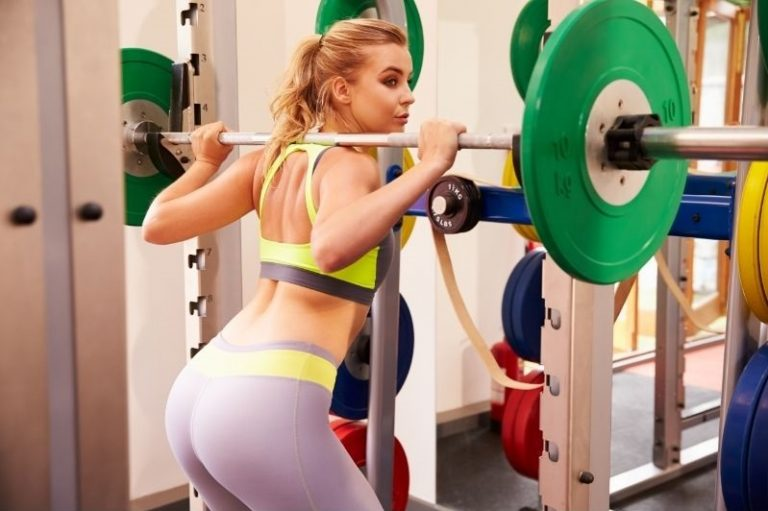Woman doing conventional squat