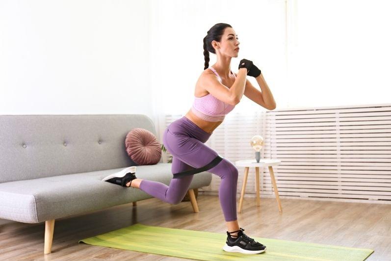 Woman doing Bulgarian split squats