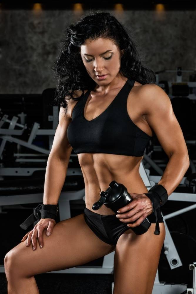 Woman training with pre workout