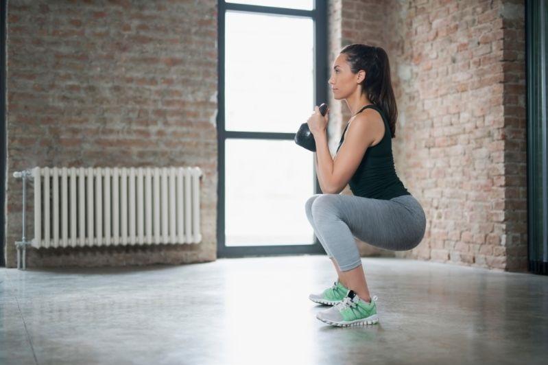Woman doing a kettlebell squat