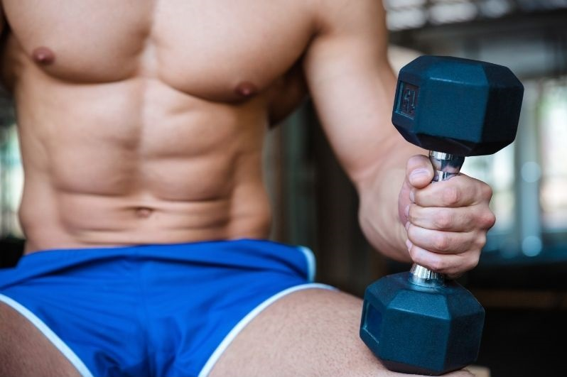 Man holding a single dumbbell