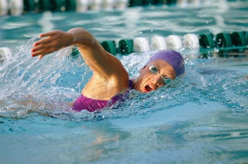 Person swimming laps in a pool