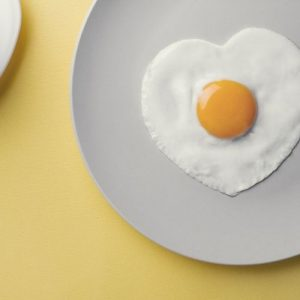 heart shaped fried egg in a plate