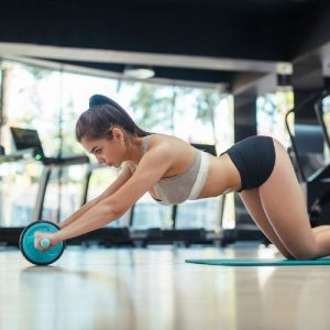woman abs wheel rollouts