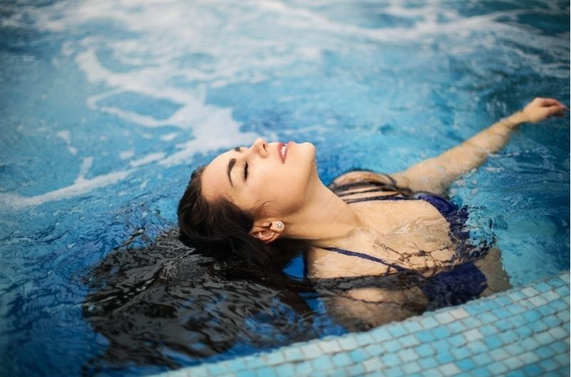 woman in swimming pool on hot day
