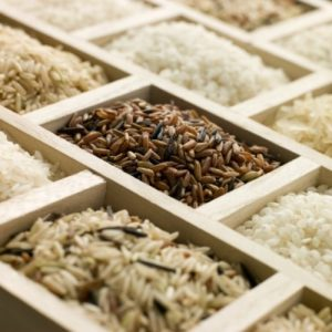 brown and white rice in boxes